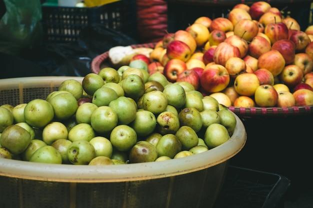 Fresh small apples at a vietnamese farmers market