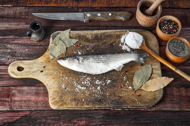 Fresh smelt fish  on the kitchen cutting board