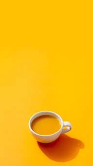 Fresh smoothie on yellow background