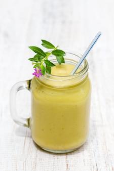 Fresh smoothies from avocado, banana, mango and honey