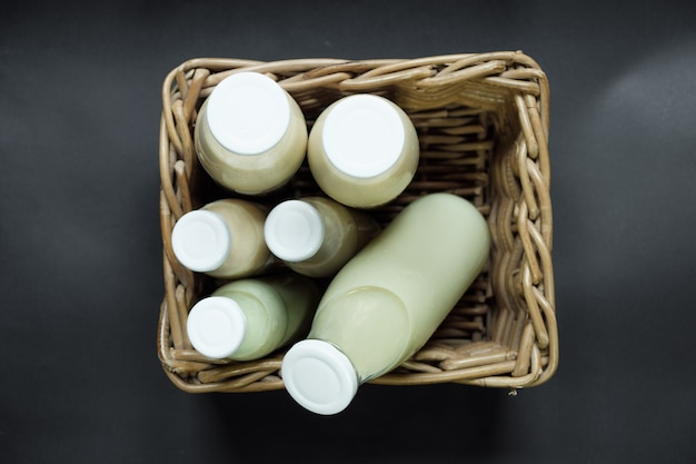 Fresh soy milk in a bottle on basket.