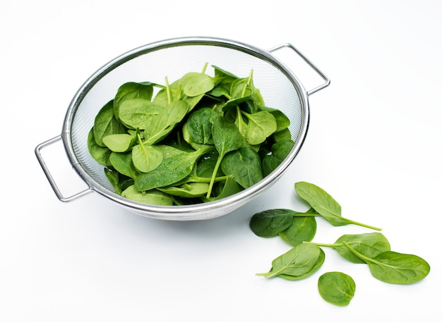 Fresh spinach leaves isolated on white