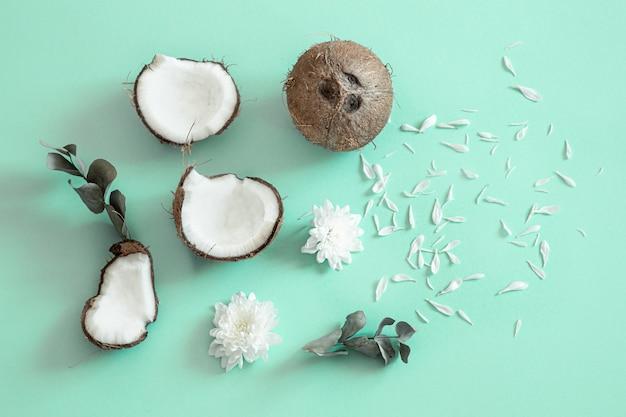Fresh split coconut on blue