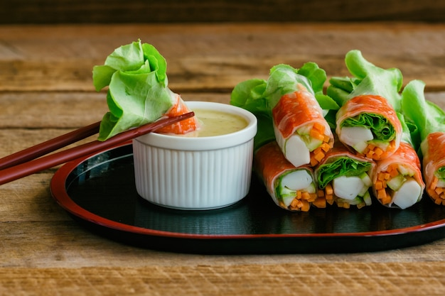 Fresh spring rolls with fresh vegetable and crab stick with wasabi mixed salad cream