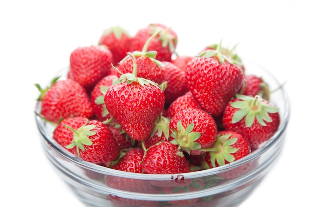 Fresh strawberries in a glass dish fruit on white