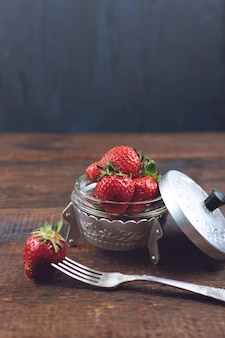 Fresh strawberries in metal plate