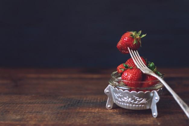Fresh strawberries in metal plate