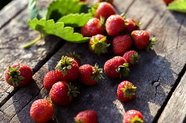 Fresh strawberries on rustic wooden background with copy space