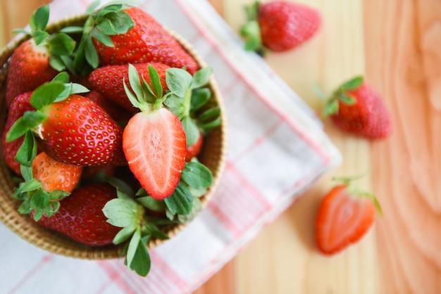Fresh strawberries on wood - ripe red strawberry picking in basket