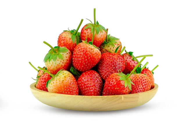 Fresh strawberries in a wooden dish isolated