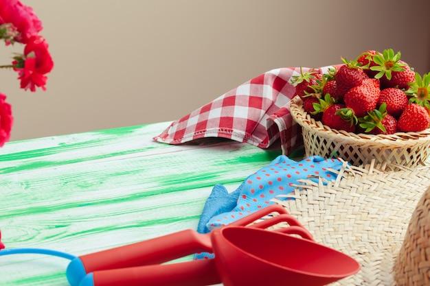 Fresh strawberry in basket on wooden background