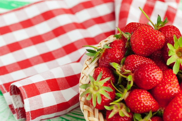 Fresh strawberry in basket on wooden