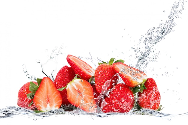 Fresh strawberry falling in water