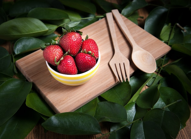 Fresh strawberry and juice on wood table. flat lay.