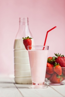Fresh strawberry milk shake on wood