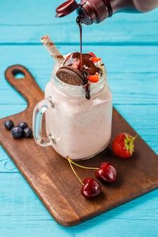 Fresh strawberry milkshake and berries sprinkles chocolate.