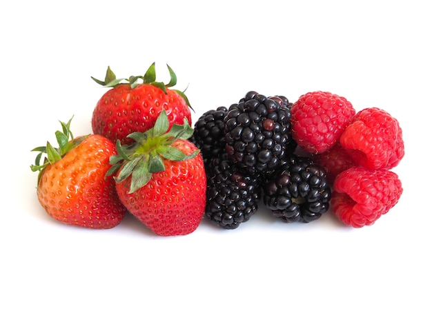 Fresh strawberry, raspberry and blackberry on wooden background, healthy food and diet.