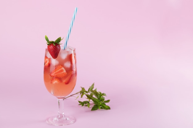 Fresh strawberry summer cocktail and ice cubes