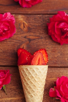 Fresh strawberry in waffle cone. creative food concept