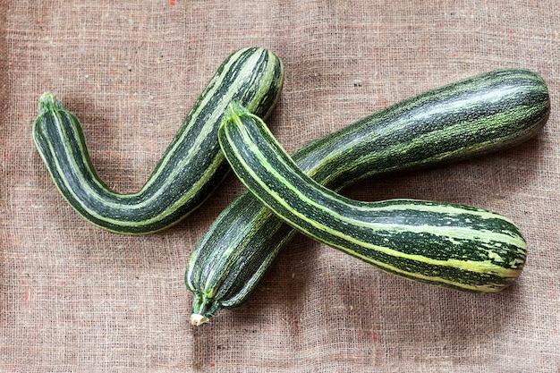 Fresh striped zucchini on sackcloth