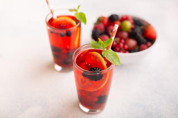 Fresh summer berry drink with lemon and mint