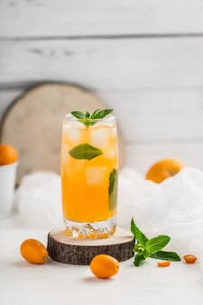 Fresh summer cocktail with orange juice and ice cubes. glass of orange soda drink