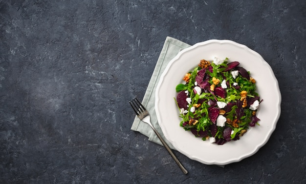 Fresh summer salad with grilled beets, feta cheese and nuts