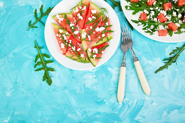 Fresh summer watermelon salad with feta cheese and arugula.