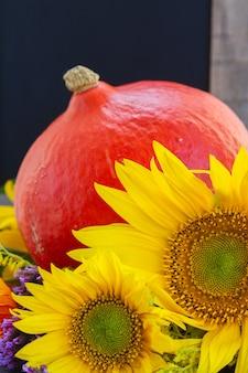 Fresh sunflowers  with raw pumpkin close up