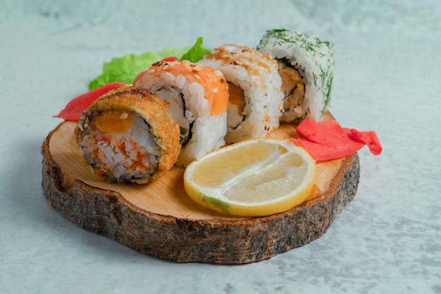 Fresh sushi rolls on wooden surface.