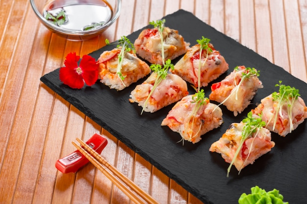 Fresh sushi on rustic wooden table