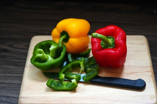 Fresh sweet bell pepper on a wooden board