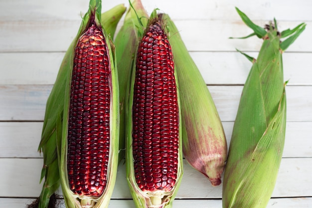 Fresh sweet corn on wood table.