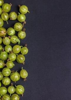 Fresh and sweet gooseberry on dark background.