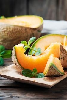 Fresh sweet orange melon and mint