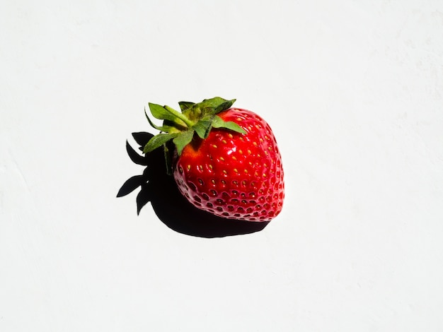Fresh sweet strawberry with shadow on white background