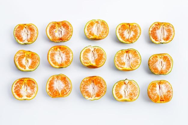 Fresh tangerine fruit on white surface