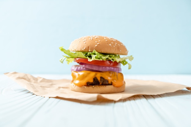 Fresh tasty beef burger with cheese and french fries