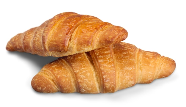 Fresh and tasty croissants over white background