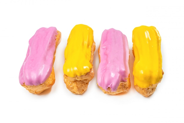 Fresh tasty eclairs isoalted on white background