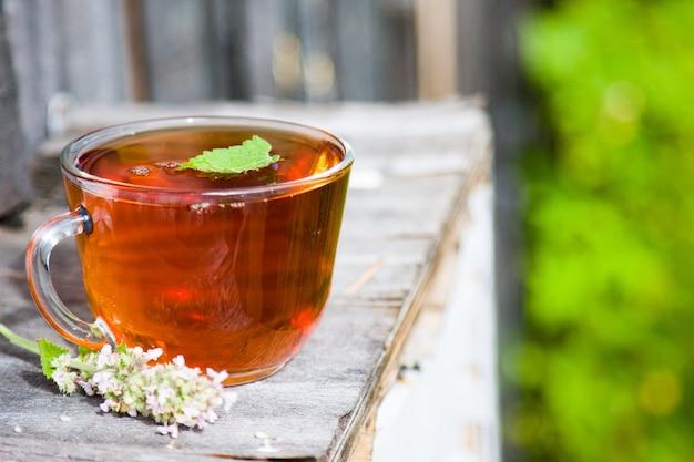Fresh tasty hot tea with melissa outdoor in summer. medicine healthy
