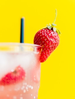 Fresh tasty strawberry in cocktail glass