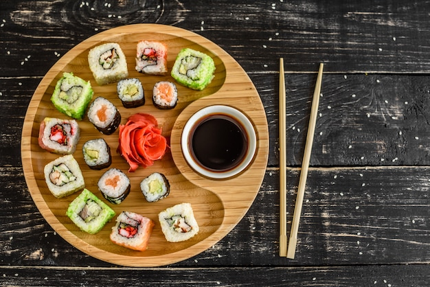 Fresh and tasty sushi on dark background. it can be used as a background