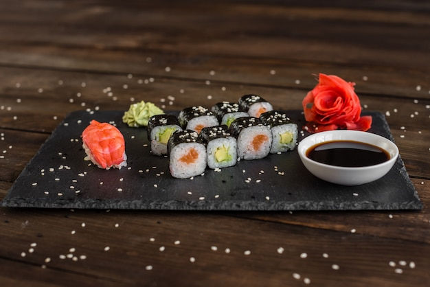 Fresh and tasty sushi on dark background.