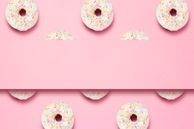 Fresh tasty sweet donuts on a pink background. place for text. concept of fast food, bakery, breakfast, sweets. minimalism. pattern.