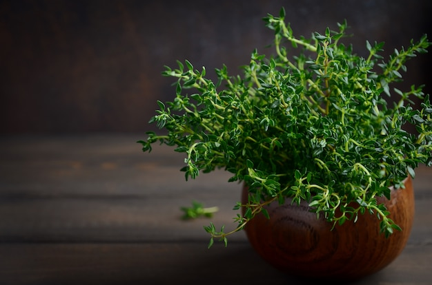 Fresh thyme on wooden background.
