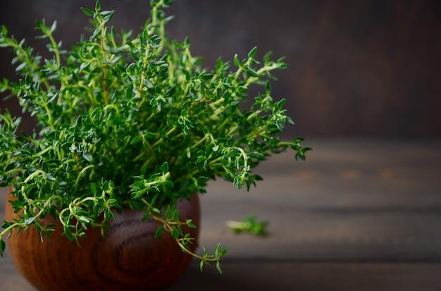 Fresh thyme on wooden pot