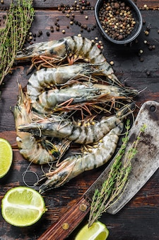 Fresh tiger shrimps, prawns with spices and herbs.
