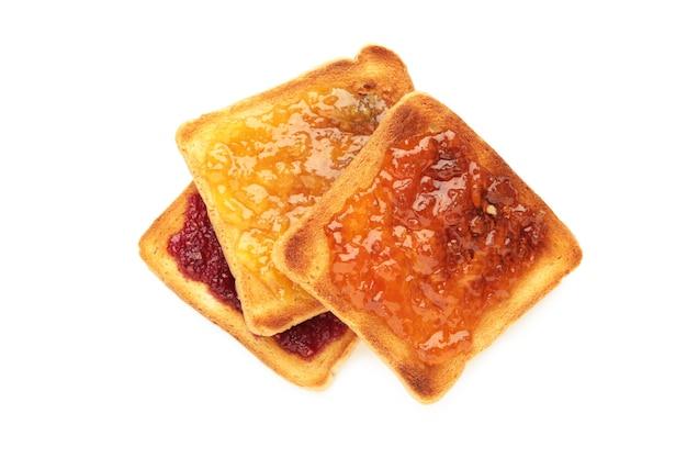흰색 배경에 분리된 버터와 다른 잼을 곁들인 신선한 토스트. 평면도