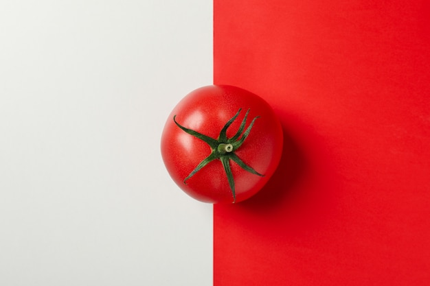 Fresh tomato on two tone background, top view
